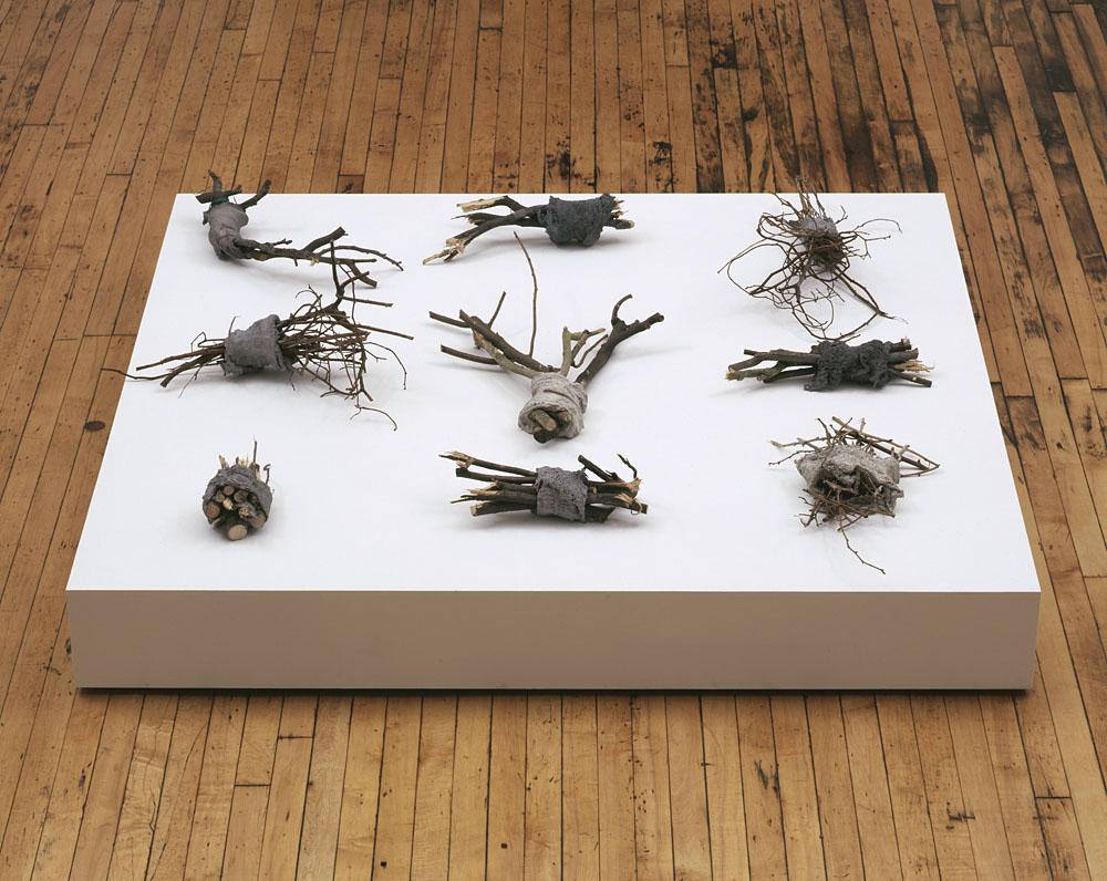 Alexandra Bircken, Calories, 2011, Wood, mortar and cloth, 9 pieces, each various dimensions, Overall 160 x 160 x 43 cm