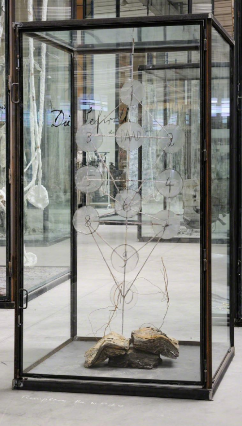 Anselm Kiefer, Die Sefiroth, 2010, Burned books, wire, steel and numbered and inscribed glass discs in inscribed glass and steel vitrine, 231 x 130,2 x 130,2 cm