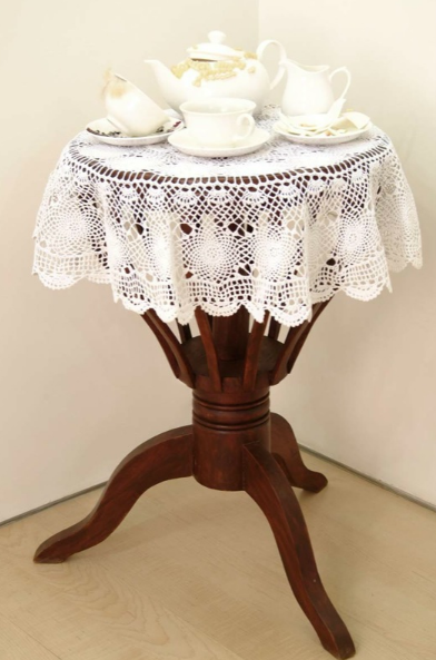 Bharti Kher, The Girl with the Hairy Lips said No, 2006, wooden table, hair, bindis, crochet, cotton, ceramic, teeth, cream,