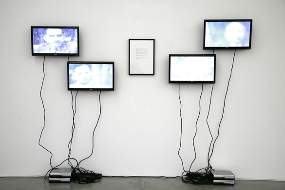 Shilpa Gupta, Hardly Bare to Speak, 2009, 4 TV monitors and a framed text piece, no sound