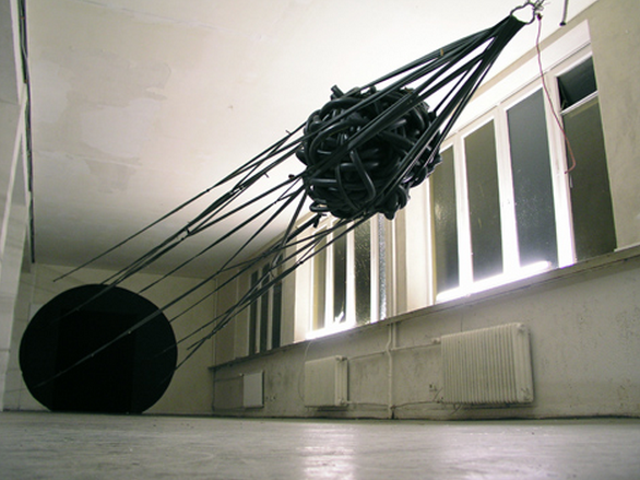 Sonja Vordermaier, Slingshot, bicycle inner tubes, tension and firing-mechanism, paint. approx. 13 x 6 m, Elektrohaus Hamburg, Germany, 2003