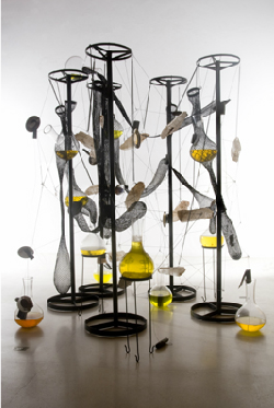 Tunga, Cooking crystals, 2006-2009, iron, steel, crystal, magnets, brown matter, yellow liquid and glass