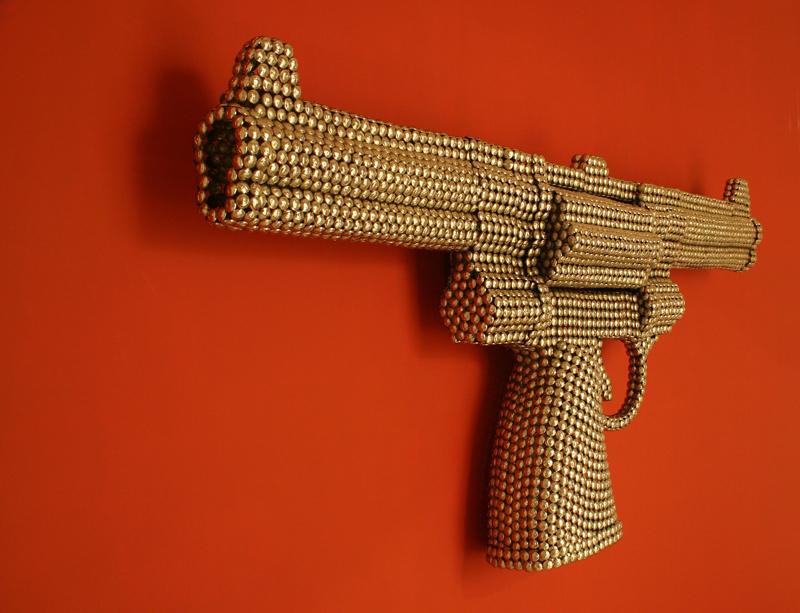 Valay Shende, Gun of Counter Revolution, 2007, detail, nickel plated embossed metal discs, 107 x 237 x 29cm