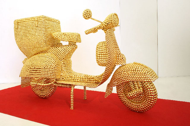 Valay Shende, Scooter, 2007, gold plated metal discs,