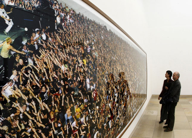 """Visitors look at the work """"Tote Hosen"""" by German photographer Andreas Gursky at the Haus der Kunst museum in Munich, Germany."""