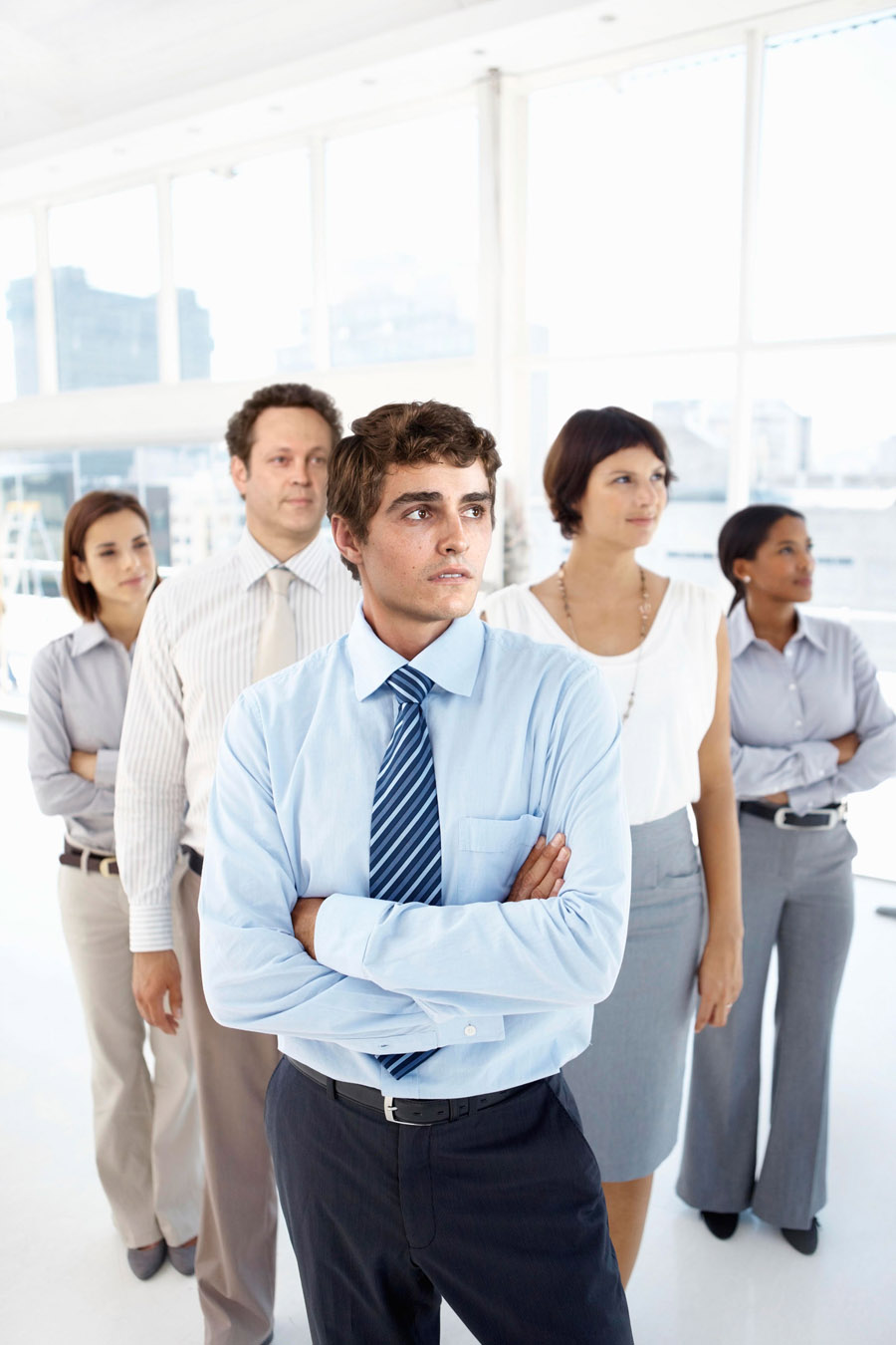 Manager with business group standing in office