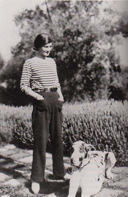 Coco Chanel at Villa La Pausa in Roquebrune, French Riviera, with her dog, Gigot, c1930.