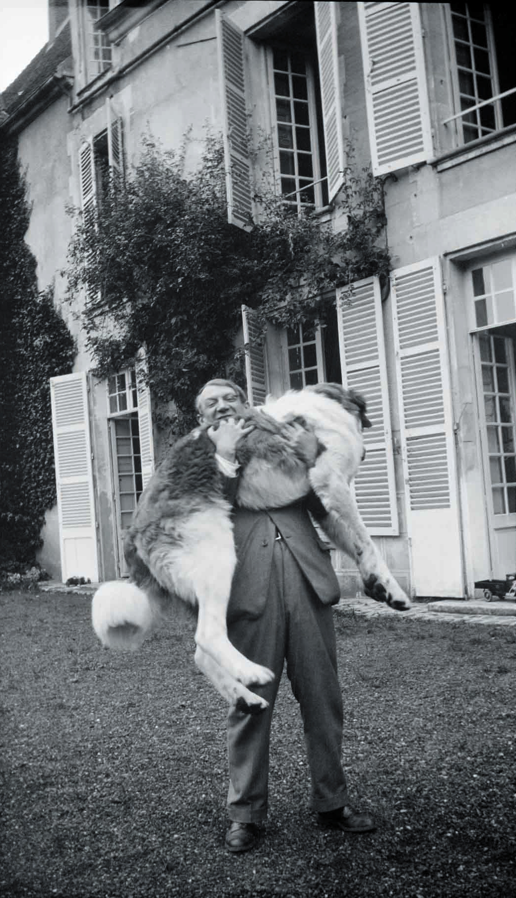 Picasso with Bob (the Great Pyrenees), shot at Château de Boisgeloup, France, 1932.