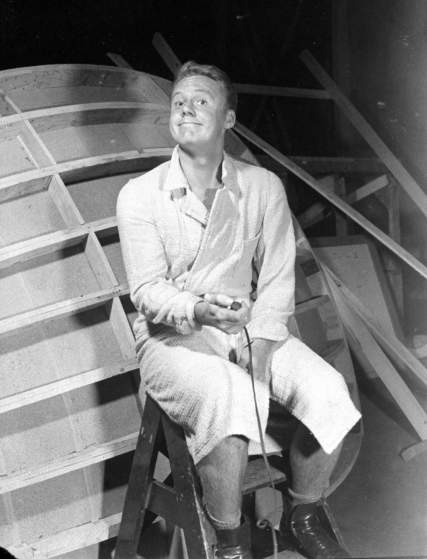 Actor Van Johnson holding shutter release as he takes his own photograph.