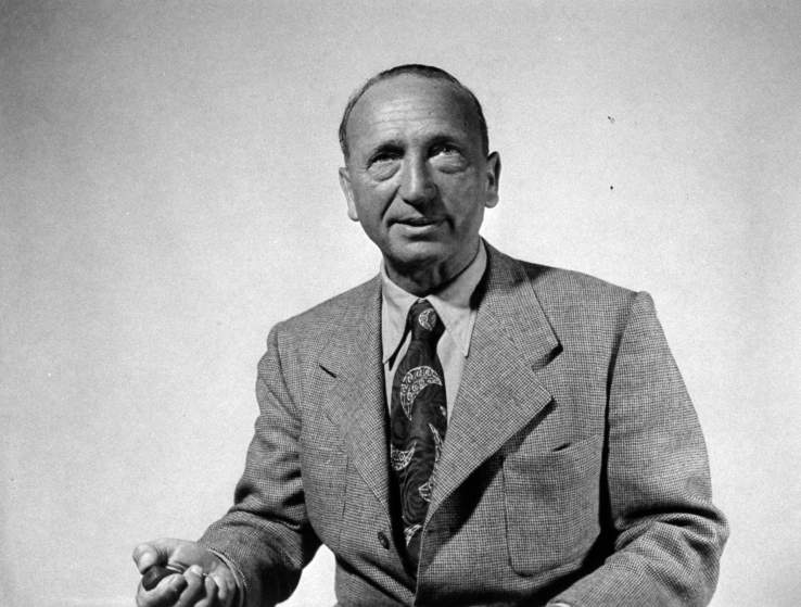 Director Michael Curtiz holding shutter release as he takes his own photograph.
