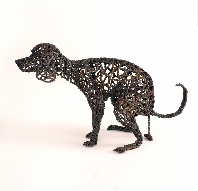 Unchained A Collection Of Dog Sculptures Made Out Of