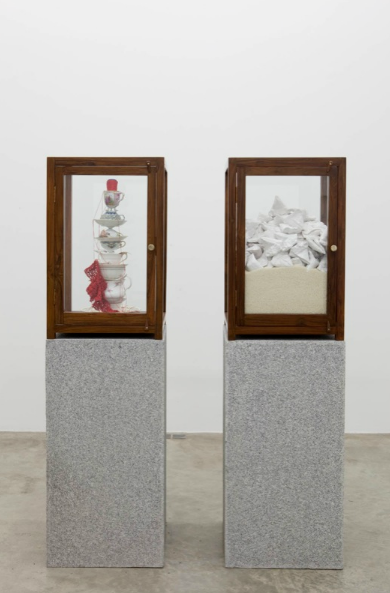 Bharti Kher, Home Maker, 2011, glass cabinets, porcelain teacups and saucers, ceramic samosas, rice, granite blocks,
