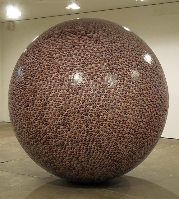 Justine Khamara, Erysichton's Ball, 2010, Collaged colour photographs, polymer based fiberglass, wood, 2,2 m diameter