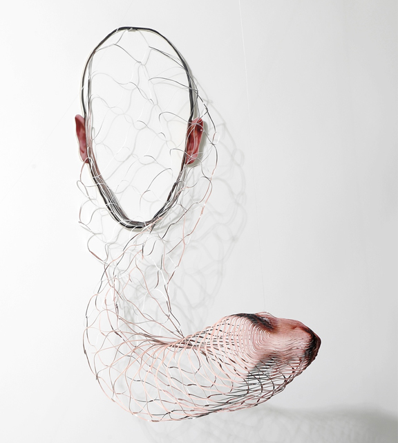 Justine Khamara, Untitled, 2008, Hand cut colored photograph, dimensions variable