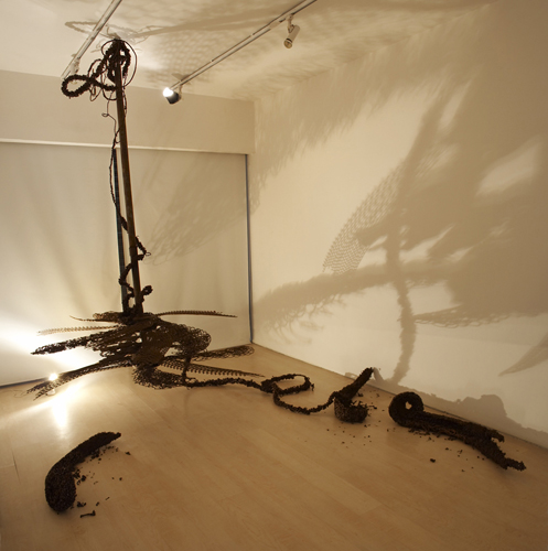 Sakshi Gupta, Some Beast, 2008, scrap iron, soldering material etc. Approx. 7' (Diameter) x 7.5' (length)