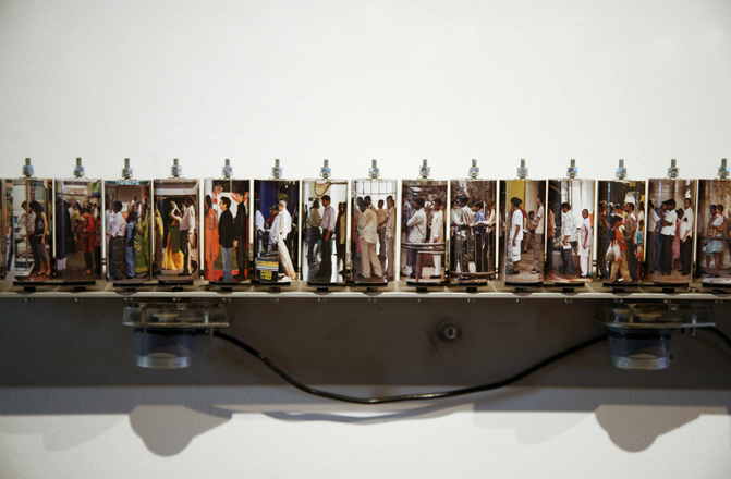Shilpa Gupta, 100 Queues, 2007-2008, 100 photographs on archival papel over spools, sensor