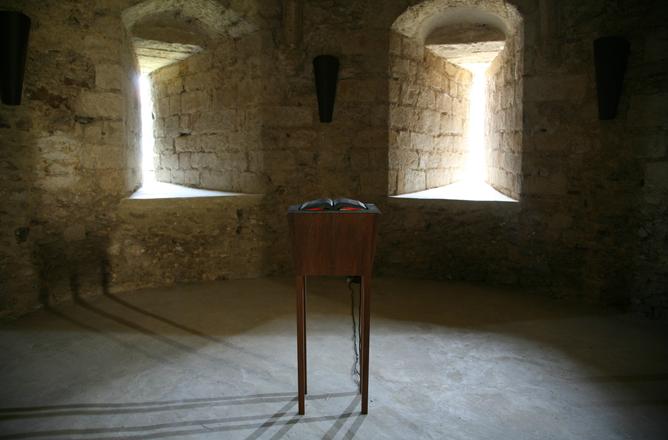 Shilpa Gupta, Untitled (heat book), 2009, heated steel book on wooden pedestal