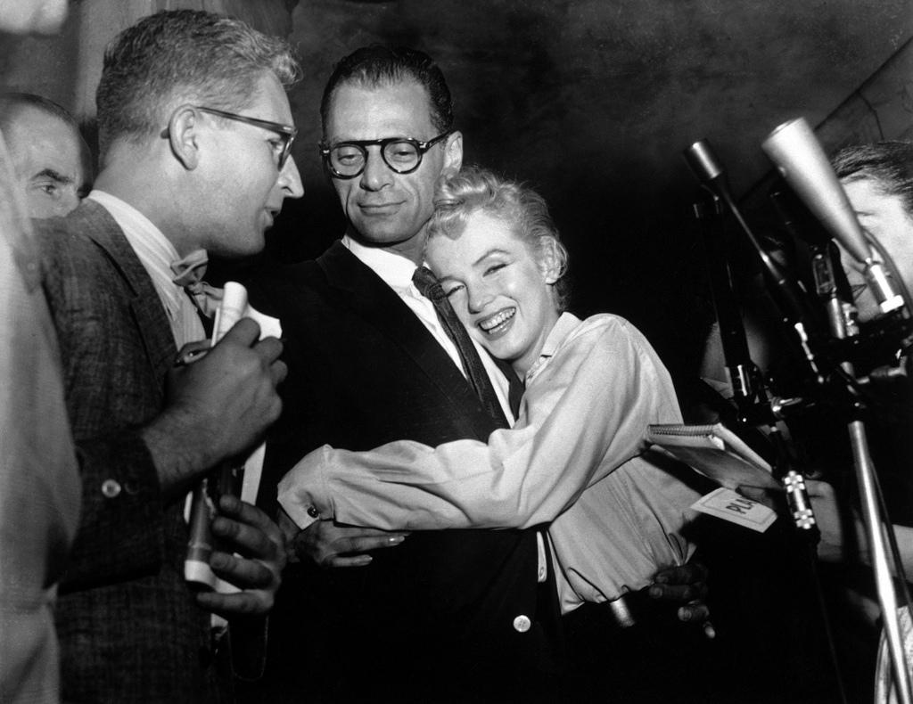 Actress Marilyn Monroe Hugging Arthur Miller