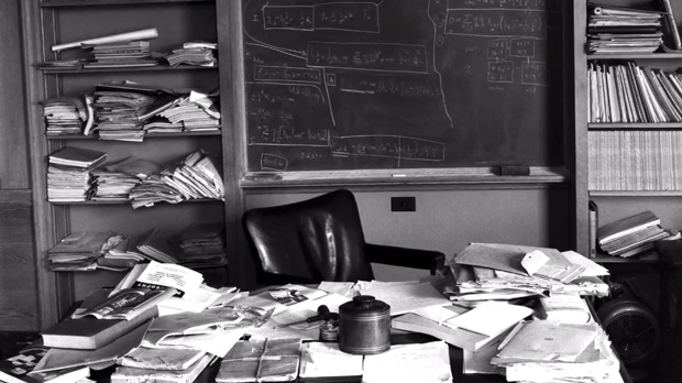 The desk of Albert Einstein, photographed immediately after his death and featuring his unfinished manuscripts of the Unified Field Theory, a.k.a. The Theory of Everything, which aspired to summarize all the physical forces in the universe.