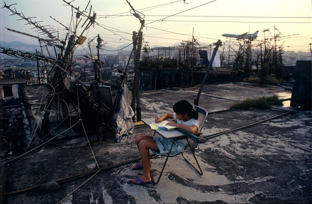 Student doing homework on Walled City rooftop, 1989