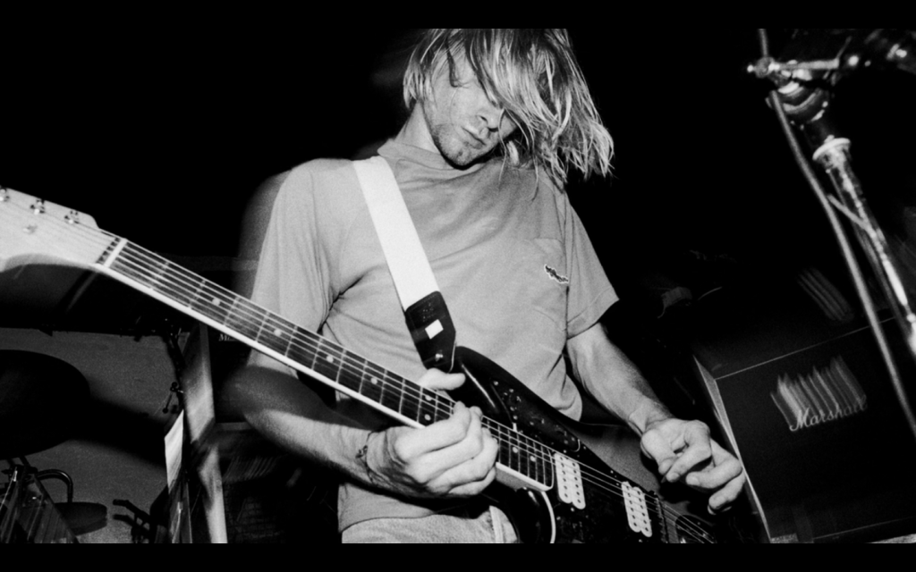 kurt_cobain_playing_the_guitar_by_cobain1337-d49tix0