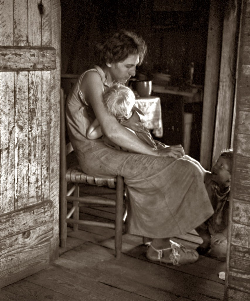Summer 1936. Lily Rogers Fields and two of her children in their Hale County, Alabama, cabin.