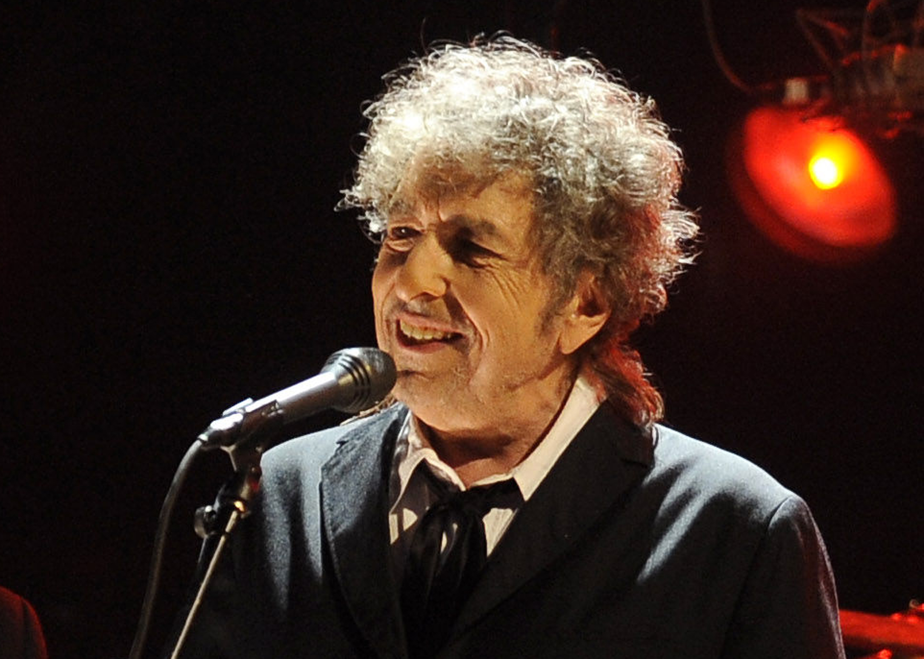 FILE - In this Jan. 12, 2012 file photo, Bob Dylan performs in Los Angeles. Fifty years into his career as a recording artist and a week away from release of an extraordinary new CD, Dylan spent his Tuesday evening where he seems to feel most comfortable — on a stage. (AP Photo/Chris Pizzello, File)