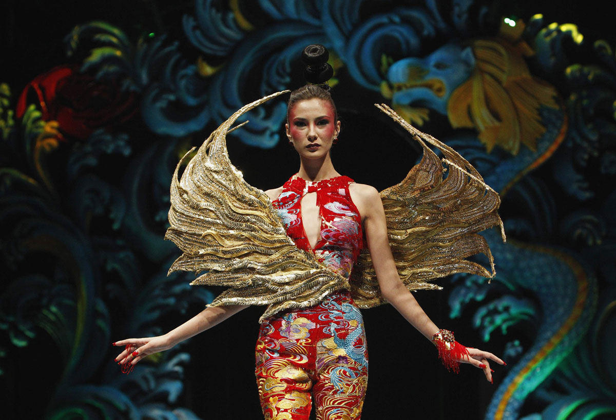 A model presents a creation by Chinese designer Guo Pei during the Asian Couture fashion show in Singapore