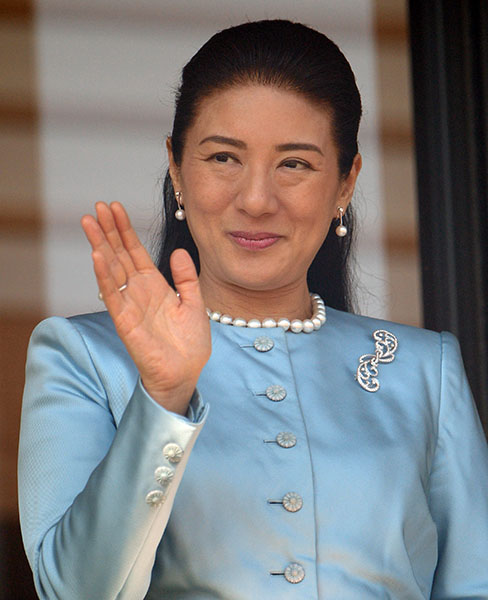 Japanese Crown Princess Masako waves to well-wishers gathered at the Imperial Palace in Tokyo on January 2, 2014. Japan's Emperor Akihito and his family greeted well-wishers for their customary New Year public appearance. AFP PHOTO / TOSHIFUMI KITAMURA (Photo credit should read TOSHIFUMI KITAMURA/AFP/Getty Images)