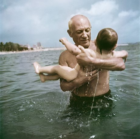 Pablo Picasso playing in the water with his son Claude, Vallauris, France, 1948